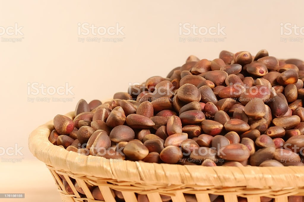 Pine nuts in a basket royalty-free stock photo