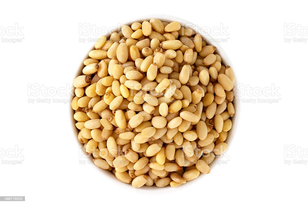 Pine nuts in a cup from above stock photo