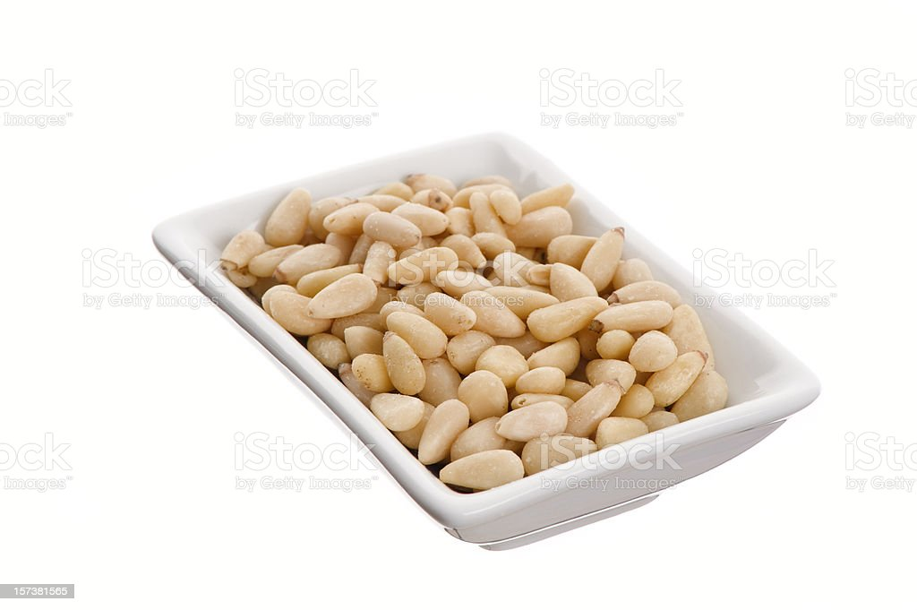 Pine nuts in a small dish royalty-free stock photo