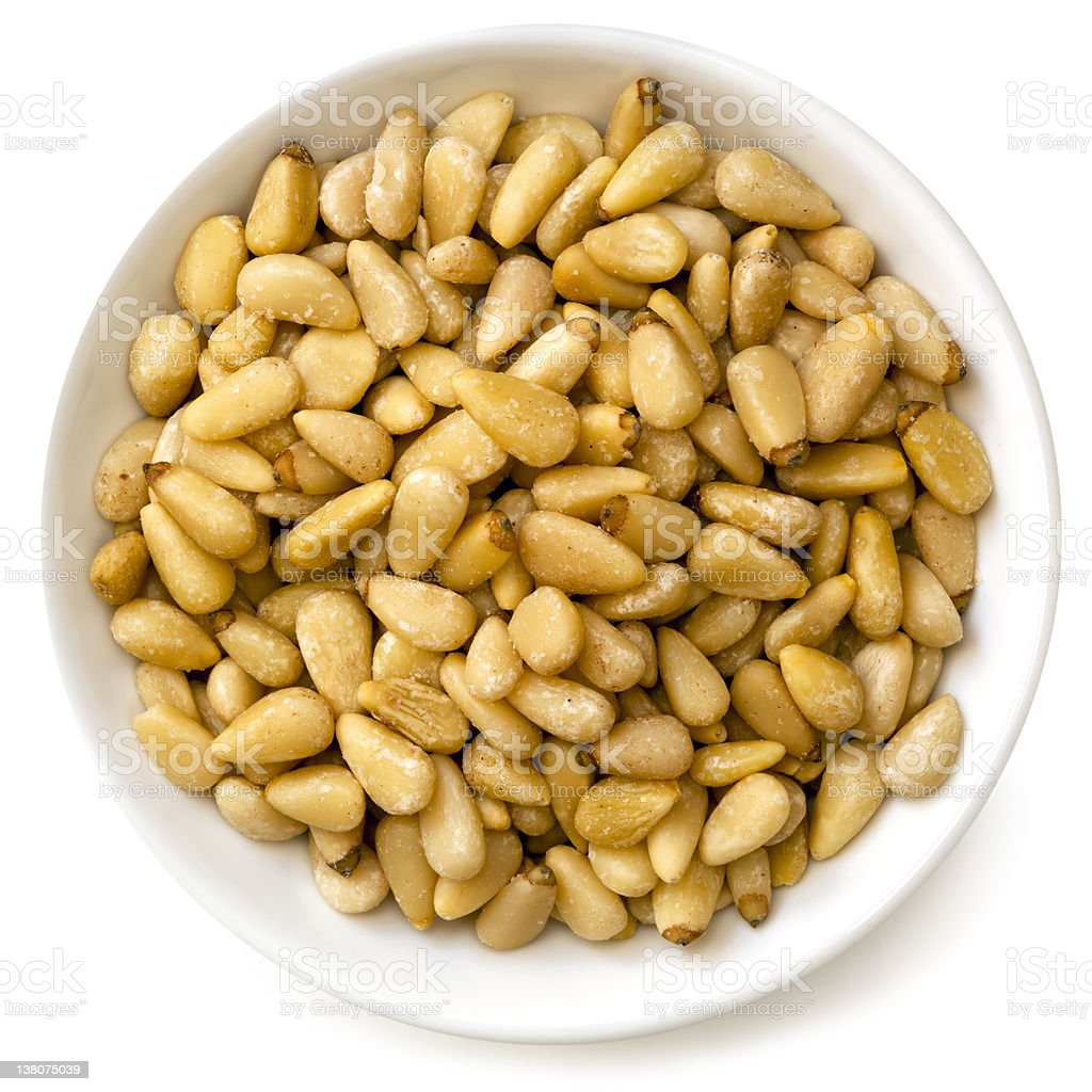 Pine Nuts in White Bowl royalty-free stock photo