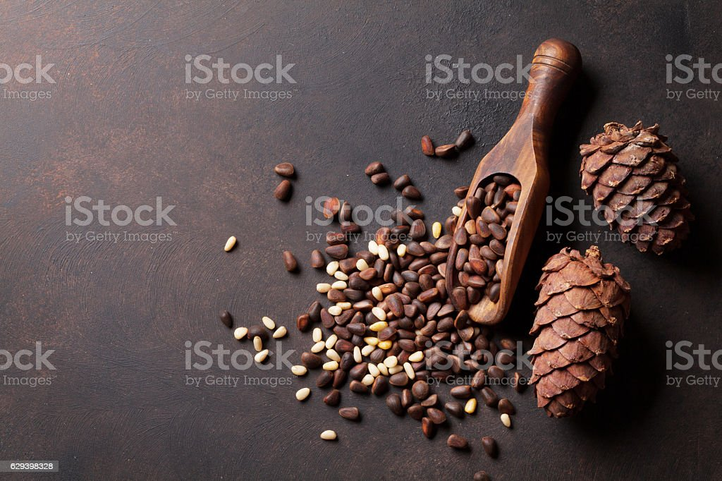 Pine nuts on stone table stock photo