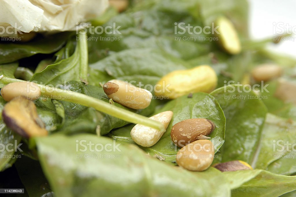 Pine Nuts over spinachs salad royalty-free stock photo