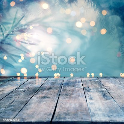 Pine tree backgound with empty wooden planks and defocused lights