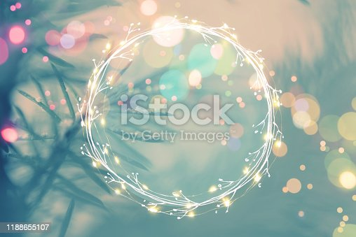 Pine tree background for Christmas Decoration with light garland and copy space for your text