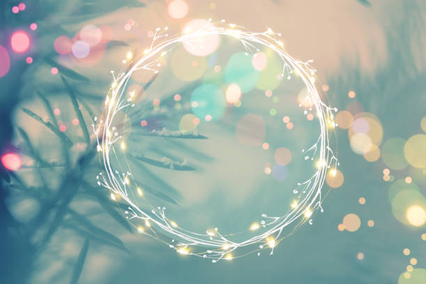 Pine tree background for Christmas Decoration with light garland and copy space for your text stock photo