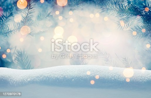istock Pine tree background for Christmas decoration with snow and defocused lights 1270970178