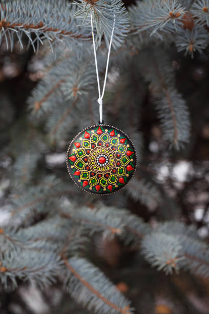 Pine tree brunches with Christmas ball stock photo