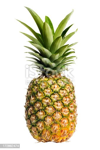 One whole pineapple, a ripe, fresh tropical fruit, cut out and isolated on a white background. The prickly exterior of the raw food hides the juicy, sweet, yellow dessert treat inside. A gourmet Hawaiian meal ingredient, the crop may be grown organically for part of a vegetarian, healthy eating diet.