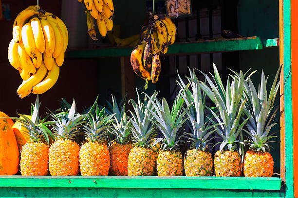 pineapple and bananas tropical fruits rustic market, latin america exoticism - caribbean food stock photos and pictures