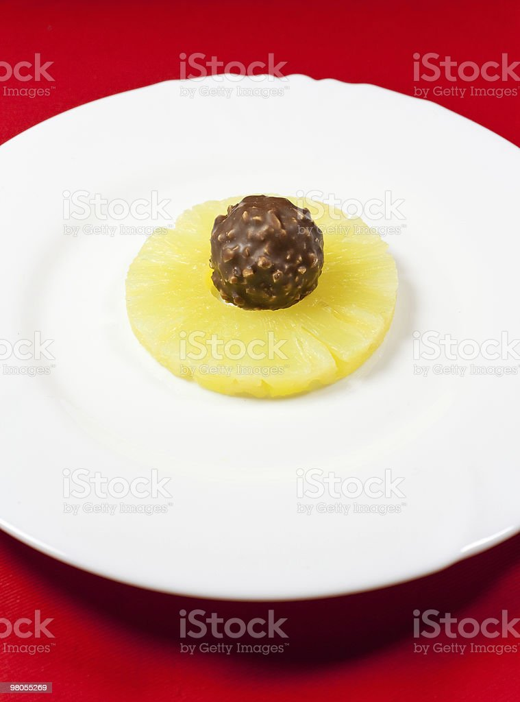 Pineapple and candy royalty-free stock photo
