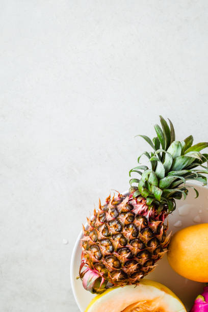 pineapple and melon fruits, minimal food photo - food styling stock photos and pictures