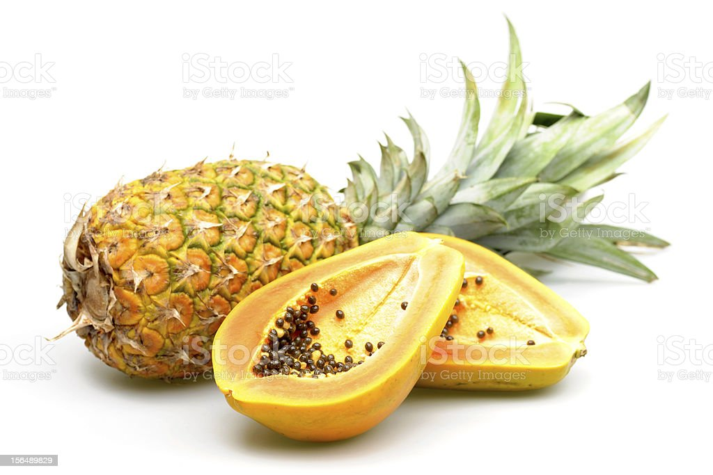 Pineapple and papaya on a white background stock photo