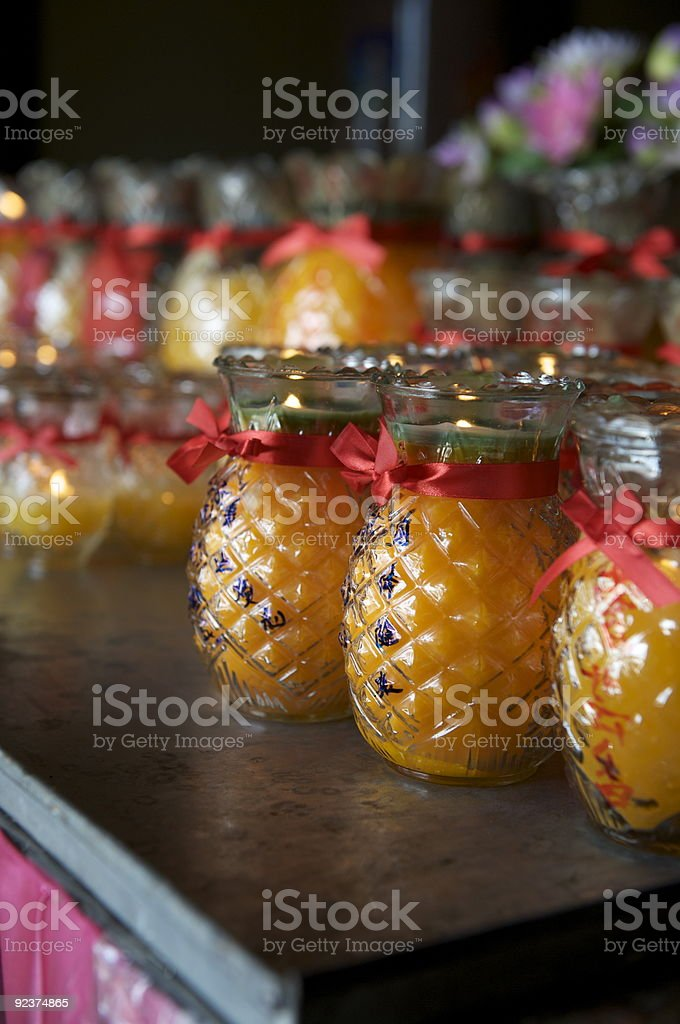 Pineapple Candles in Local Temple royalty-free stock photo