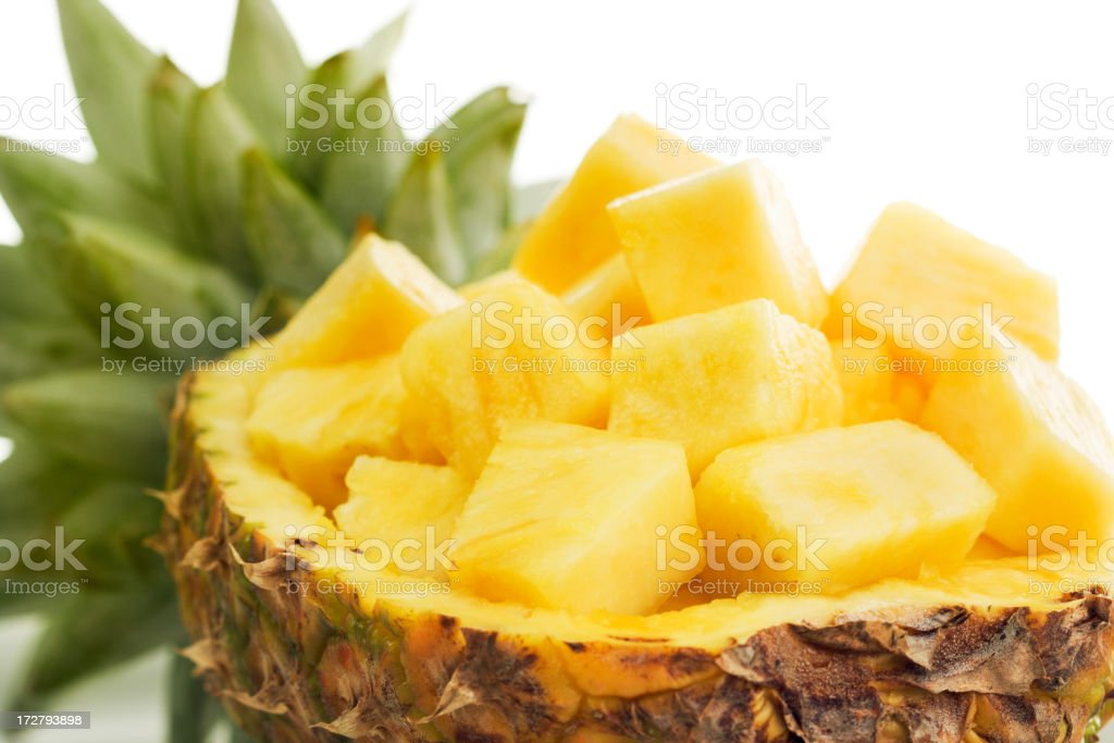 Pineapple Cubes Prepared and Presented on Half Fruit royalty-free stock photo