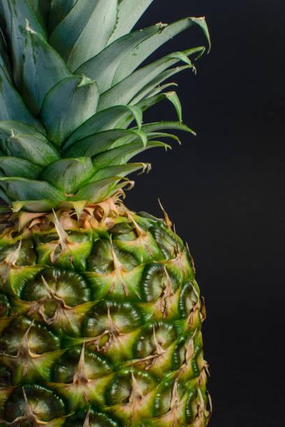 pineapple fruit close up, black background stock photo