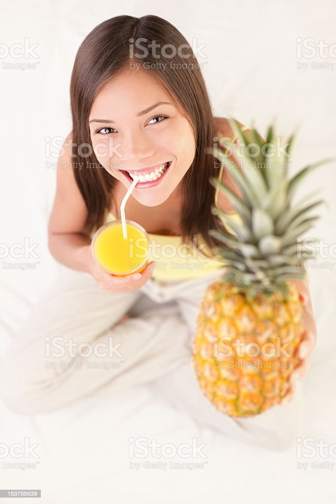 Pineapple fruit juice drinking woman royalty-free stock photo