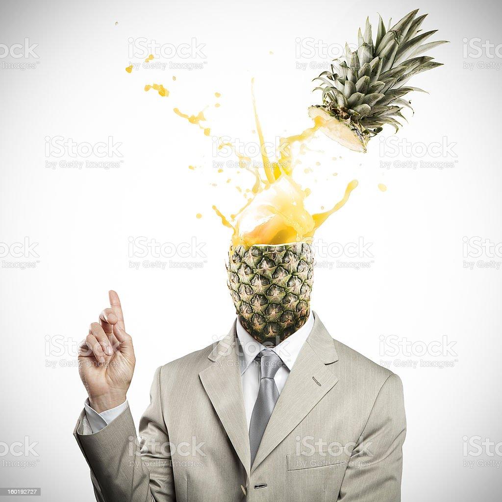 Pineapple headed businessman having an explosive idea stock photo