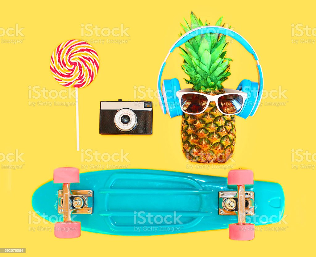 Pineapple headphones sunglasses lollipop caramel vintage camera skateboard stock photo