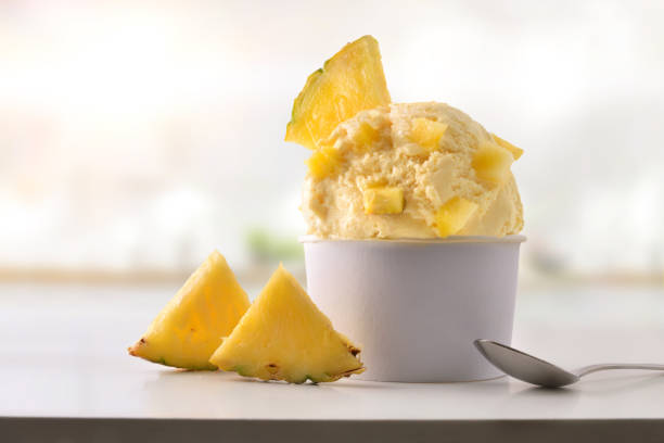 Pineapple ice cream cup on white table homemade in kitchen stock photo