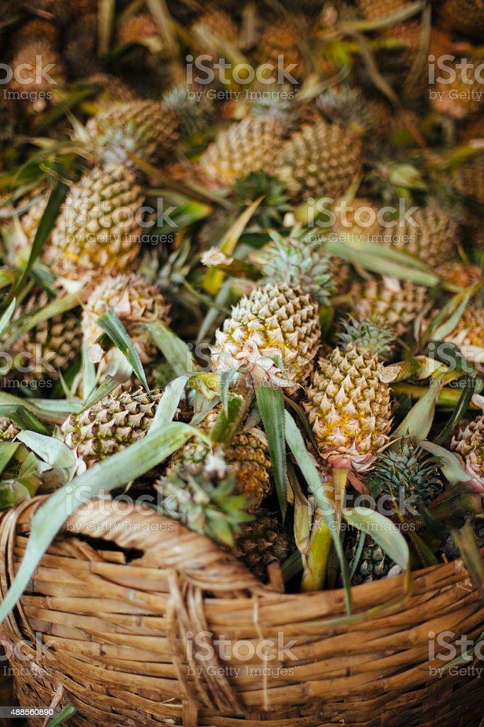 Pineapple in a wicker basket stock photo