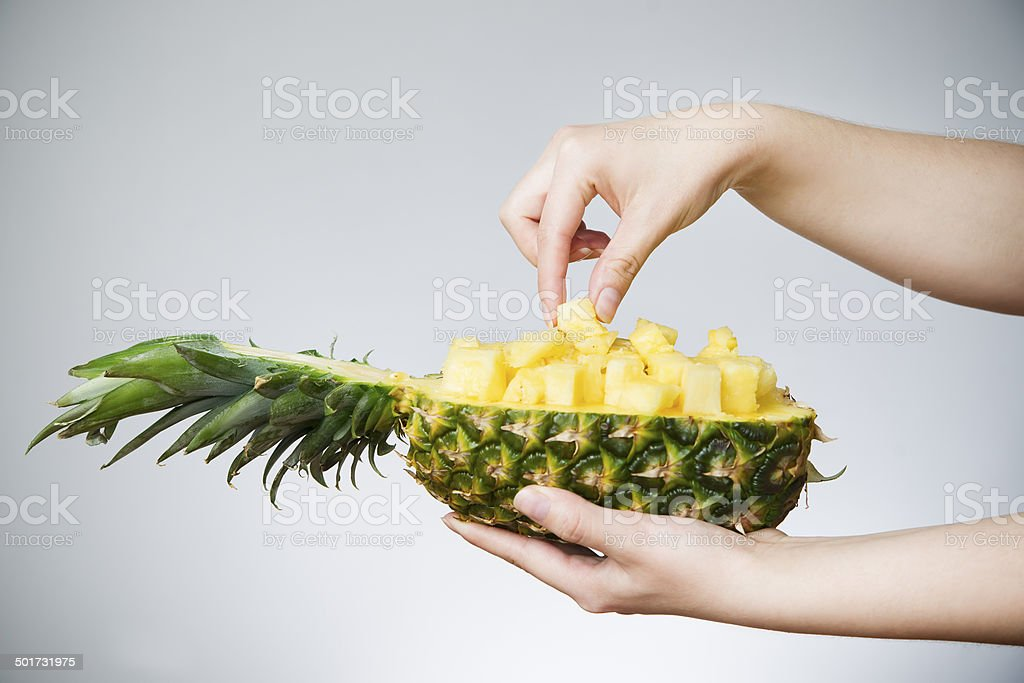 Pineapple in female hands stock photo