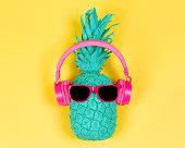 Pineapple in pink headphones