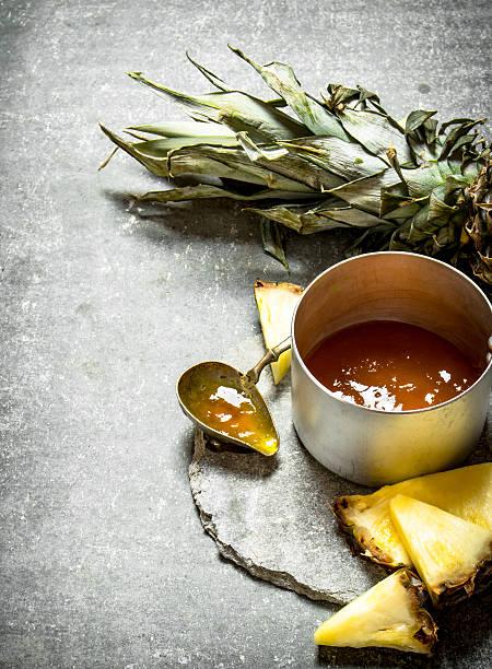 pineapple jam in a small saucepan. - ananas marmelade stock-fotos und bilder