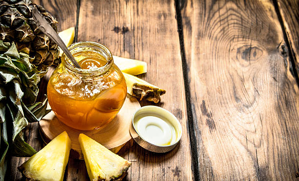 pineapple jam with pieces. - ananas marmelade stock-fotos und bilder