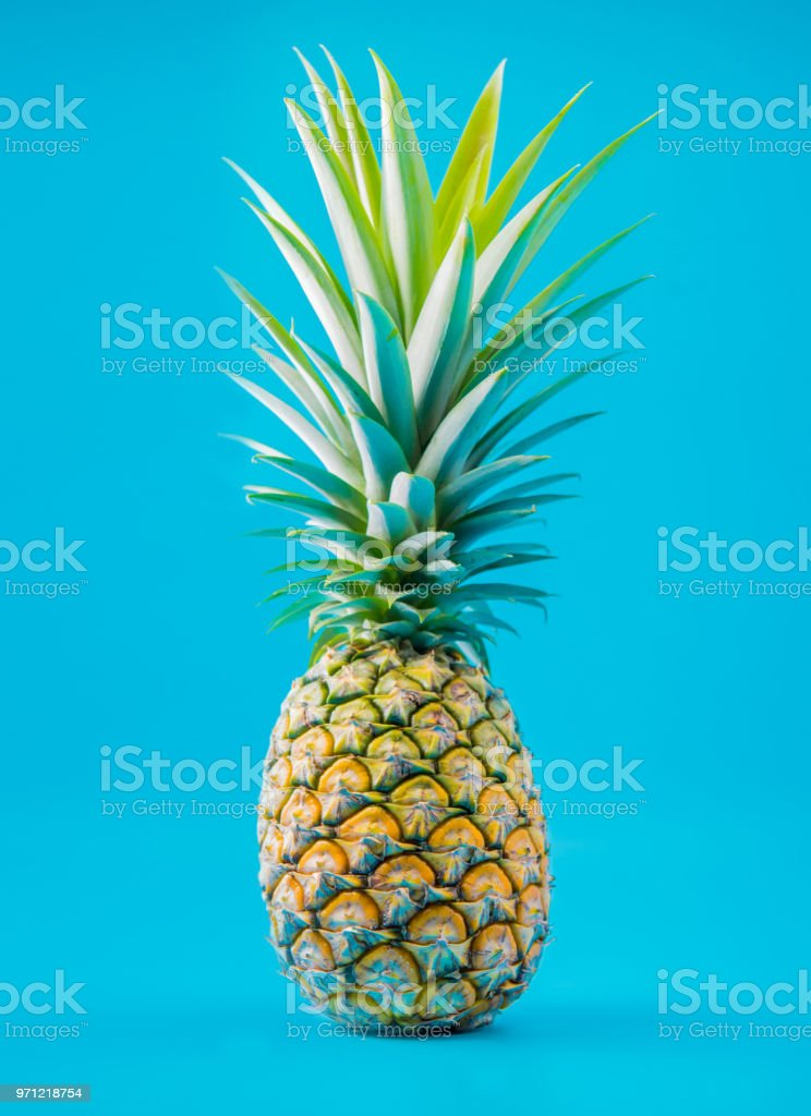 pineapple, juicy tropical Thai fruit on blue background