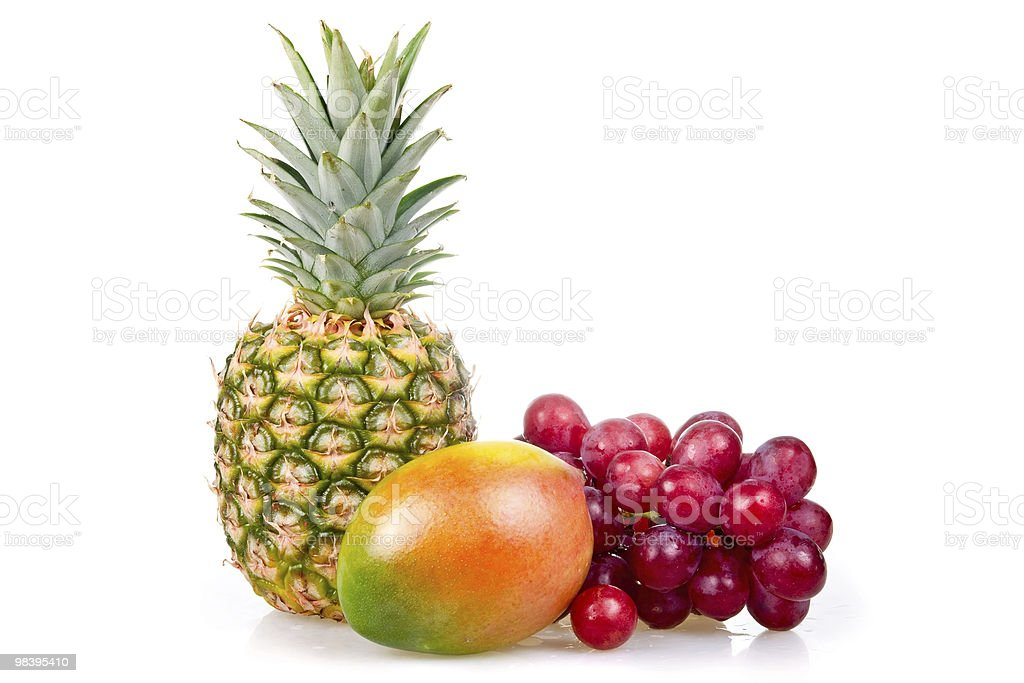 Pineapple, mango and grapes isolated royalty-free stock photo