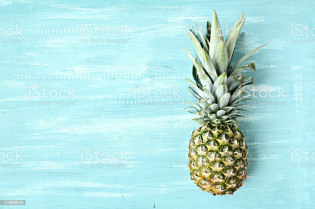 Pineapple on a blue pastel background, summer background
