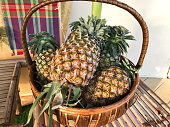 Pineapple or Ananas comosus in the basket.