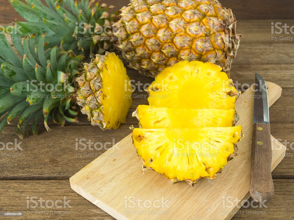 pineapple pineapple and pineapple slice on wood table. for health. 2015 Stock Photo