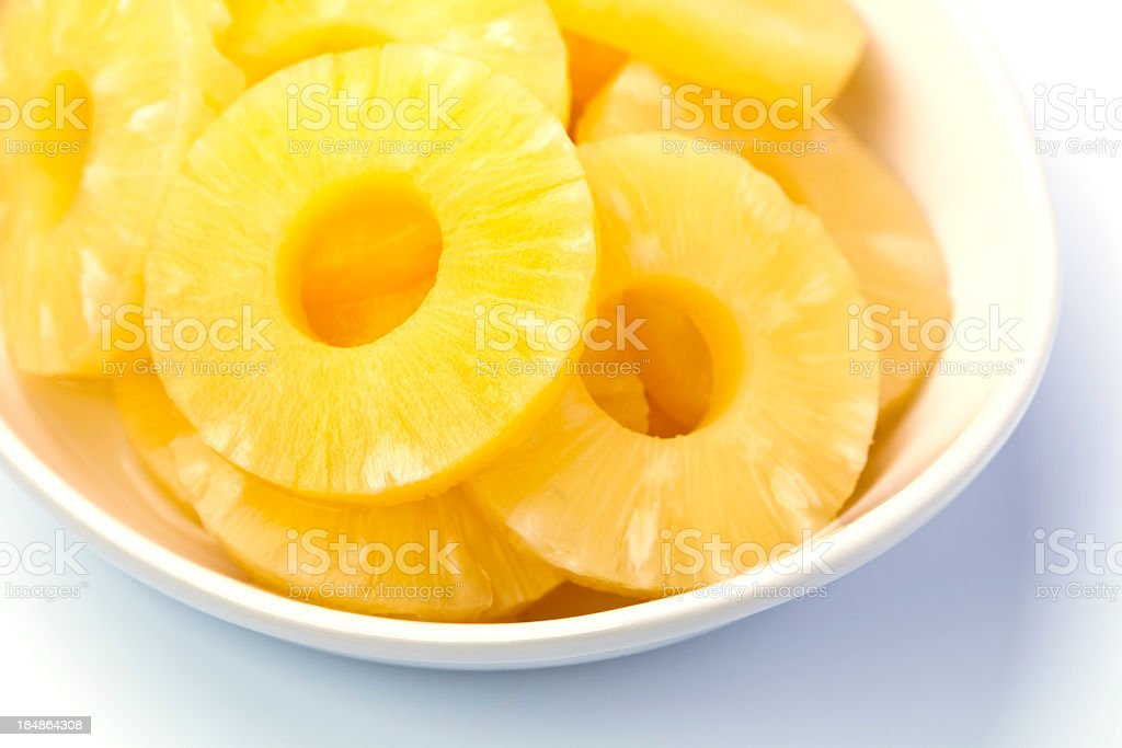 Pineapple rings served in white bowl stock photo