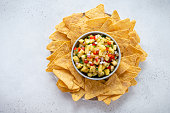 Pineapple salsa with nachos, summer party food