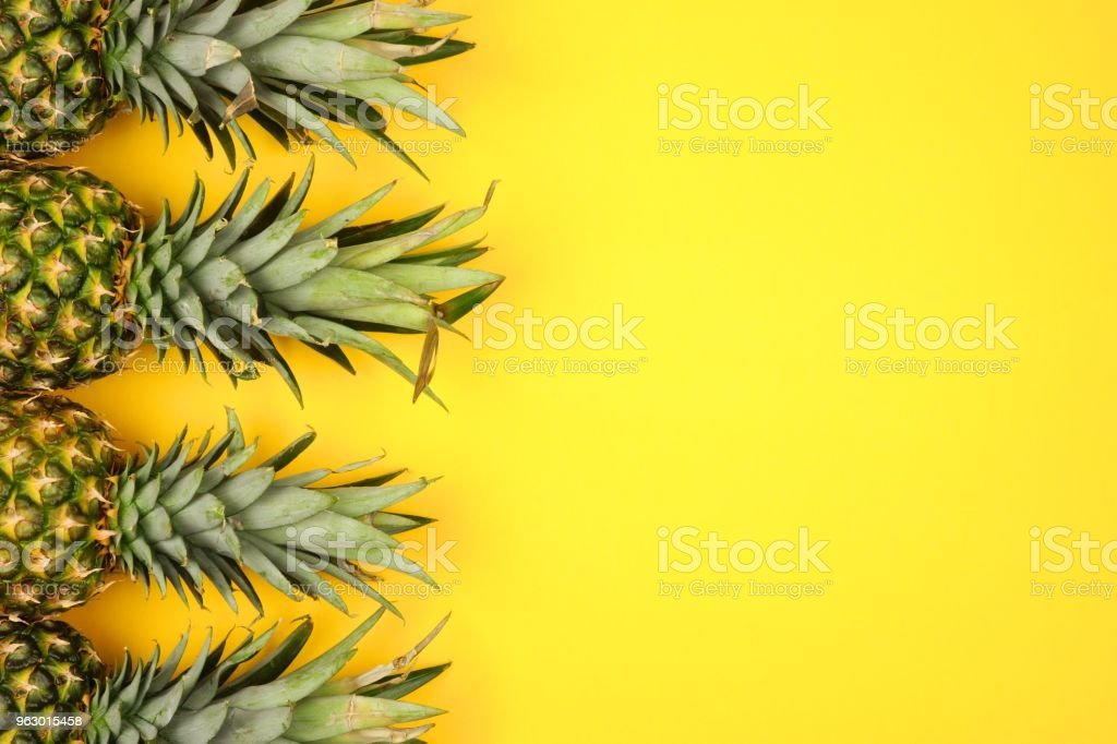 Pineapple side border on a bright yellow background stock photo