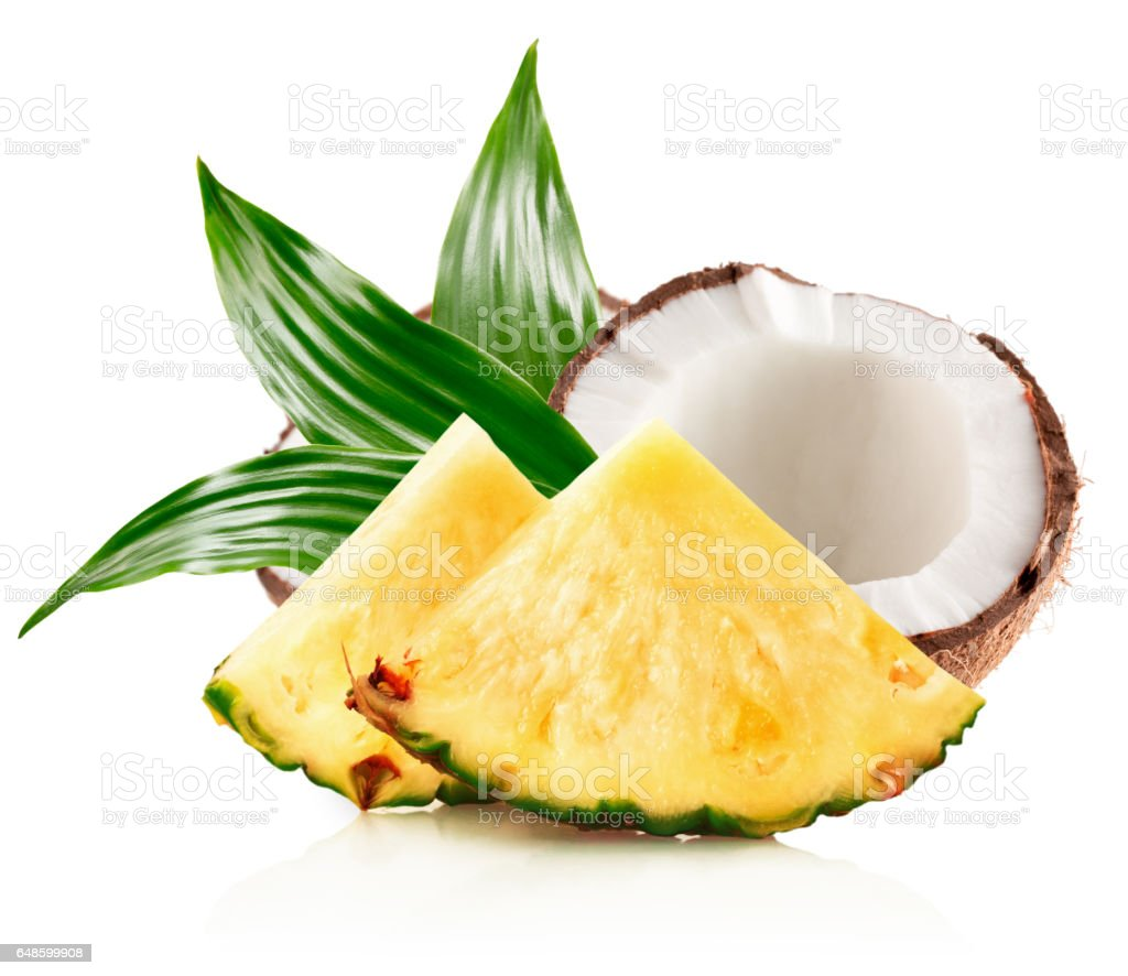 pineapple slices and half of coconut isolated stock photo