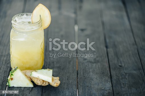 istock pineapple smoothie on wood background 674702162