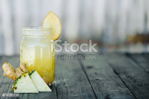 istock pineapple smoothie on wood background 674702210