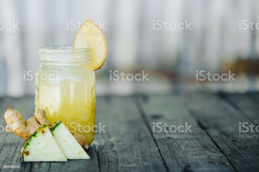 pineapple smoothie on wood background stock photo