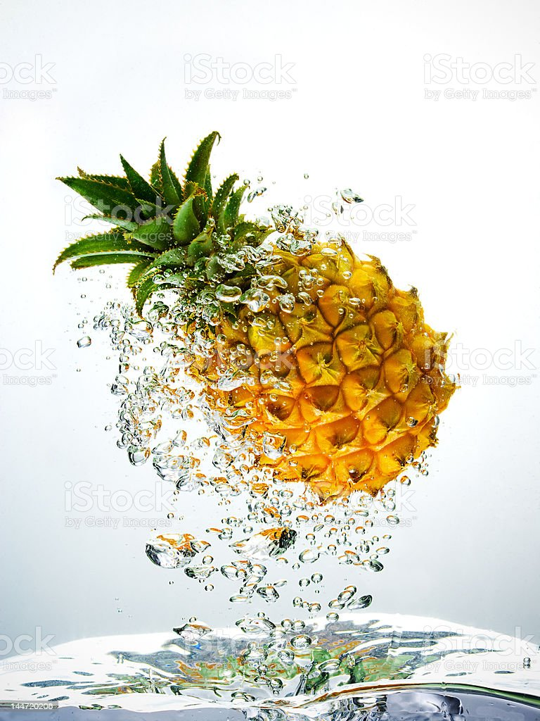 Pineapple splashing in water royalty-free stock photo
