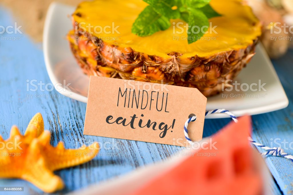 pineapple, watermelon and text mindful eating stock photo