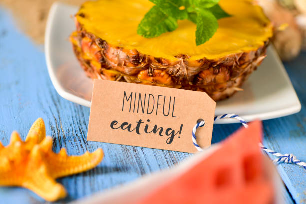 pineapple, watermelon and text mindful eating - mindfulness stock photos and pictures