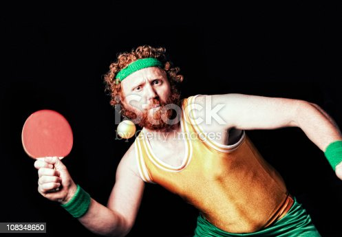 Old school ping pong player in action. He dares you to lob one.