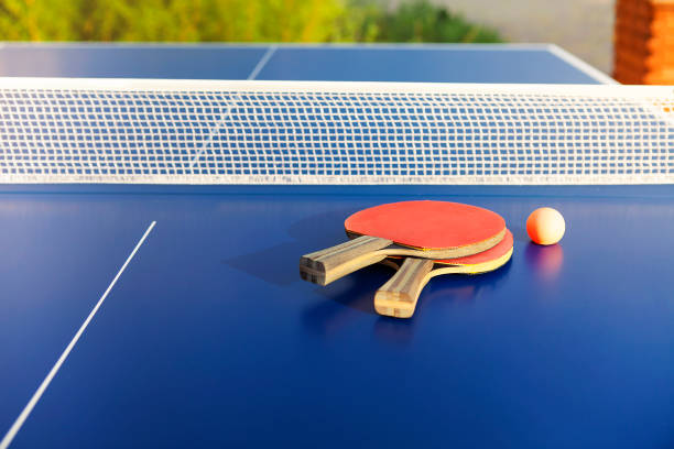 Ping pong equipment on blue table stock photo
