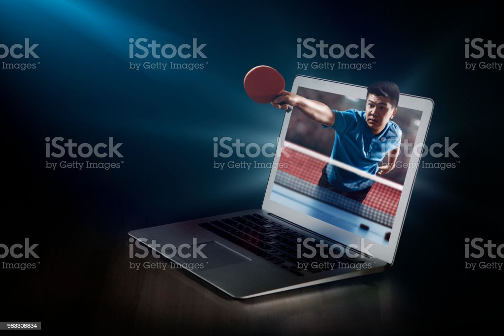 Ping pong on laptop. Live broadcast stock photo