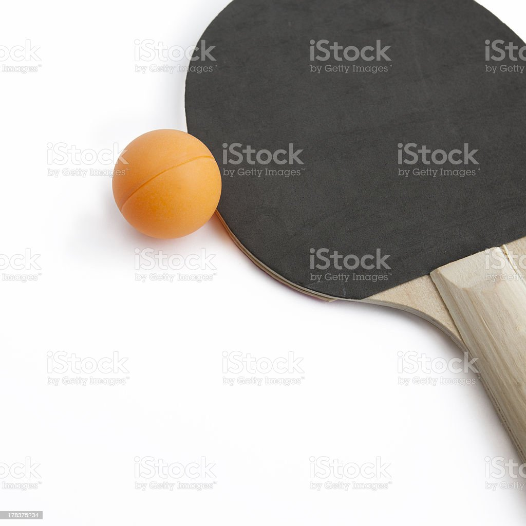 Ping pong paddle with orange ball royalty-free stock photo