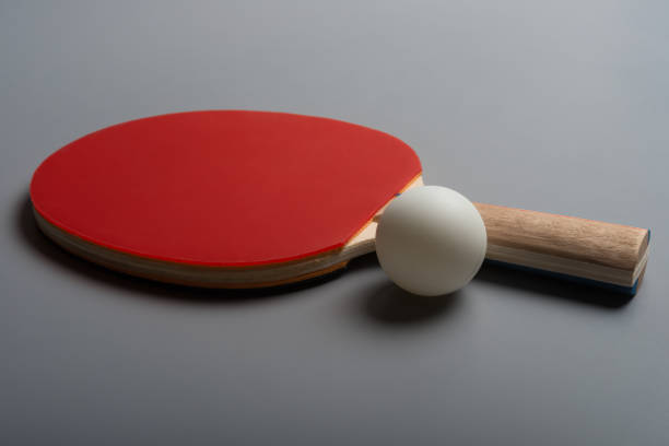 pingpong rackets and ball on a grey background - table tennis racket stock pictures, royalty-free photos & images