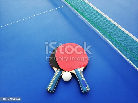 istock Ping-pong rackets and ball 1012534324