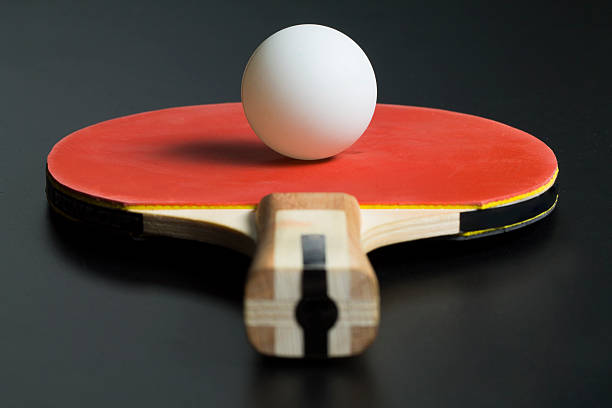 ping-pong red racket and white table tennis ball - table tennis racket stock pictures, royalty-free photos & images